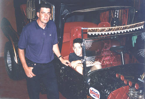 Steve Connolly and son at the Cars of the Stars museum in England